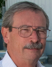 Tom Zimmerman: Man with glasses, gray hair and mustache